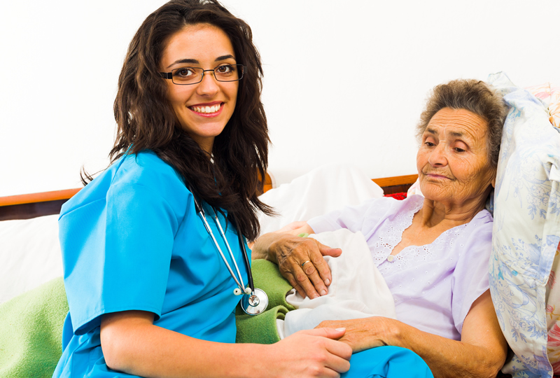 bigstock-Nurse-Caring-For-Elder-Patient1